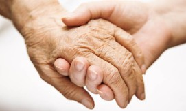 A young hand holding an elderly hand 665 x 400